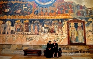 <h5>Women Reading in Svetitskhoveli</h5><p>Mother and daughter reading against a wall of thousand-year-old frescoes.																																																			</p>