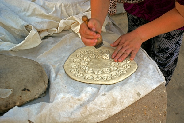 Stamping the Bread - Closeup