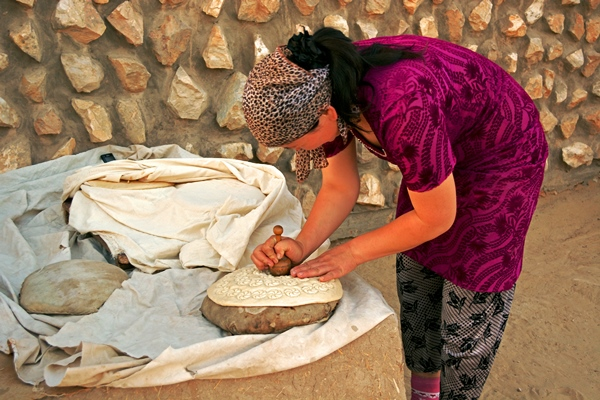 Kazakh Woman Stamping Bread