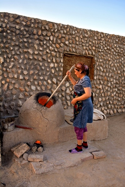 Kazakh Woman Stoking the Tandyr